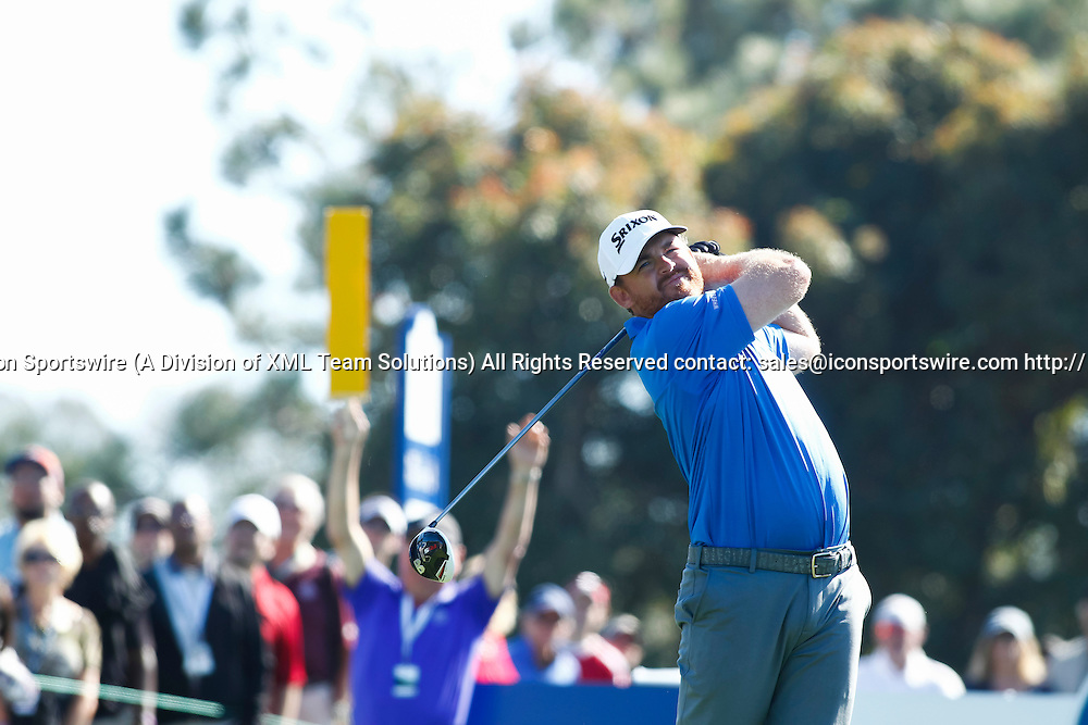 February 7, 2015:  J.B. Holmes drives the 18th hole on the Torrey Pines Golf Course during the third round of the Farmers Insurance Open in San Diego, Ca.