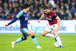 Robert Snodgrass of West Ham United takes on Son Heung-Min of Tottenham Hotspur - Mandatory by-line: Robbie Stephenson/JMP - 31/10/2018 - FOOTBALL - London Stadium - London, England - West Ham United v Tottenham Hotspur - Carabao Cup