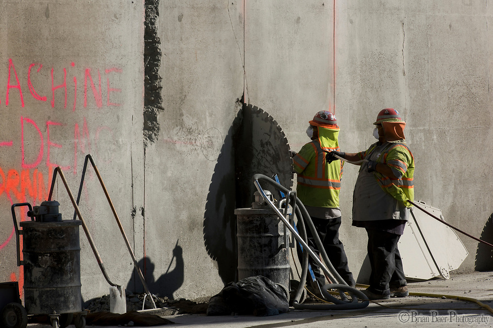Workers work to remove a pinched concrete saw blade that was used to cut the side wall of the upper chute the spillway. Photo taken July 19, 2017. <br /> <br /> Brian Baer/ California Department of Water Resources<br /> FOR EDITORIAL USE ONLY