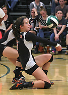 Springville's Tracy Kilburg (3) goes to a knee for a dig in the Class 1A regional final match at Iowa City West High School in Iowa City on Wednesday, November 6, 2013. Springville defeated New London 3-2.
