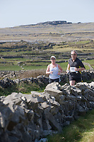 A weekend of glorious weather welcomed approximately 150 people from all over the country and abroad to Inis Mor , Arann Islands to participate in the annual Aer Arann half marathon.  Over the past ten years people have walked and ran the roads of Inis Mor to raise in excess of 1.2 million to purchase vital life saving equipment for sick children in both Crumlin and Temple Street hospitals. Galway Auctioneer  Colm Donnellan and his wife Anna passing Dún Aonghasa  . Photo:Andrew Downes.