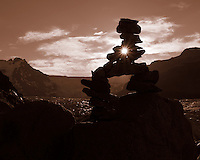 Sunburst Through a Rock Cairn Silhouette Overlooking a Glacier in Skaftafell National Park, Iceland. Image taken with a Leica X2 camera (ISO 100, 24 mm, f/11, 1/500 sec). Nikonians Academy Photo Adventure with Mike Hagen and Tim Vollmer