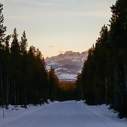 The sunsets over the Tetons as seen from Flagg Ranch in Yellowstone National Park in winter.