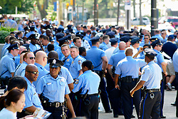 Philly 4th of July Jam, Benjamin Franklin Parkway, Philadelphia, PA USA - July 4 2012; Police officers of the Philadelphia Police Department gather pefore heading out patrolling the event. After last year's rumored gunshots a massive police presence was on hand. At the outside perimiter of the event multiple shooting incidents took place later in the evening...( Nikon D2X | ISO200 | 170mm | f/5.6 | 1/100 )