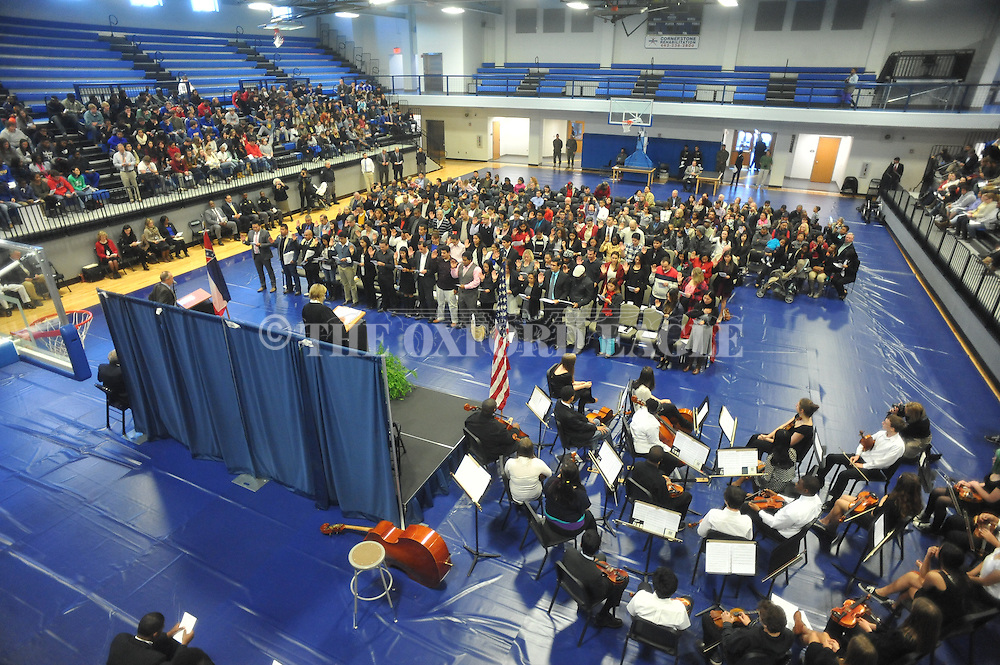 New citizens take the oath of citizenship during a Naturalization Ceremony in U.S. District Court for the Northern District of Mississippi, at Oxford High School in Oxford, Miss. on Tuesday, November 18, 2014. The ceremony was the first the court has ever held at the school.
