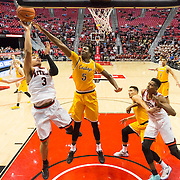 31 January 2017:  The San Diego State Aztecs men's basketball team hosts Wyoming Tuesday night at Viejas Arena. San Diego State guard Trey Kell (3) attempts a layup while being defended by Wyoming forward Alan Herndon (5) in the second half. The Aztecs beat the Cowboys 77-68 at half time. www.sdsuaztecphotos.com