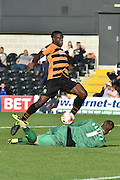 John Akinde of Barnet kicks towards the goal but ball is saved by Liam O'Brien of Dagenham and Redbridge  during the Sky Bet League 2 match between Barnet and Dagenham and Redbridge at Hive Stadium, London, England on 26 September 2015. Photo by Ian Lyall.