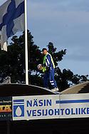 06.08.2003, Tammelan Stadion, Tampere, Finland..Suomen Cup, 6.kierros / Finnish Cup 6th round.Tampere United v Rovaniemen Palloseura.J?rjestysmies hakemassa palloa katsomon katolta.©Juha Tamminen