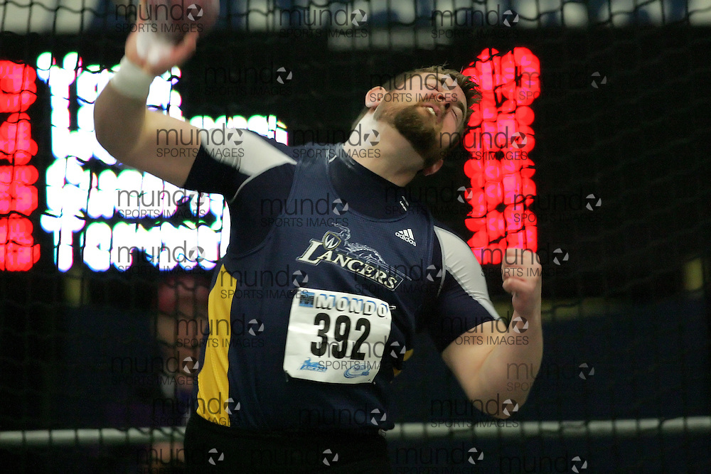 (Windsor, Ontario---13 March 2010) Mike Miller of University of Windsor Lancers   competes in the men's shot put at the 2010 Canadian Interuniversity Sport Track and Field Championships at the St. Denis Center. Photograph copyright Sean Burges/Mundo Sport Images. www.mundosportimages.com