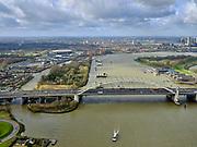 Nederland, Zuid-Holland, Rotterdam, 25-02-2020; Van Brienenoordbrug over de Nieuwe Maas, skyline centrum Rotterdam. De brug bestaat uit twee boogbruggen en huisvest Rijksweg A16, richting Breda. Links het eilandVan Brienenoord<br /> Van Brienenoord bridge over the Nieuwe Maas. The bridge consists of two arched bridges. Motorway / highway A16, direction Breda.<br /> <br /> luchtfoto (toeslag op standard tarieven);<br /> aerial photo (additional fee required)<br /> copyright © 2020 foto/photo Siebe Swart