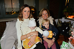 The Ivy Chelsea Garden's Guy Fawkes Party & Launch of The Winter Garden was held on 5th November 2016.<br /> Picture shows:-NATALIE PINKHAM with her mother and her children WILF & WILLOW WALBYOFF