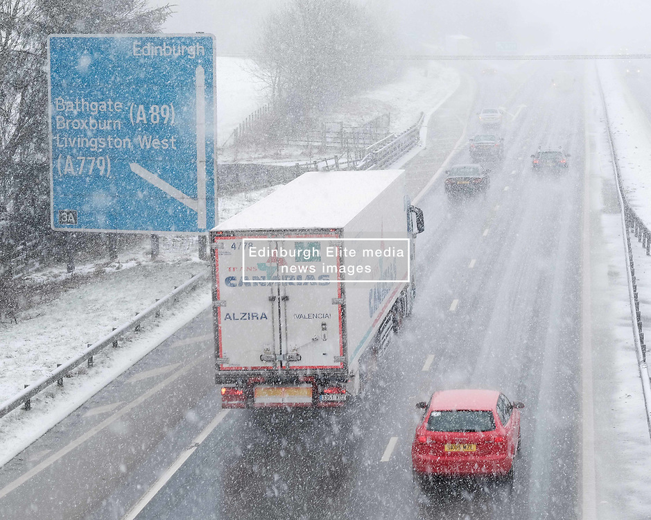 Heavy Snowfall in West Lothian, Wednesday, 4th April 2018<br /> <br /> More heavy snow fell in West Lothian this afternoon causing traffic problems for drivers on the M8 Edinburgh to Glasgow motorway.<br /> <br /> Alex Todd | EEm