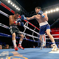 Puerto Rican Olymian Jeyvier Cintron (R) fights against Edson Noria during a Telemundo boxing match between at Osceola Heritage Park on Friday, February 23, 2018 in Kissimmee, Florida.  (Alex Menendez via AP)