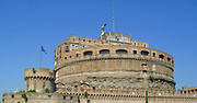 The Mausoleum of Hadrian, known as the Castel St Angelo a towering cylindrical building in Parco Adriano, Rome, Italy. It was commissioned by the Roman Emperor Hadrian as a mausoleum for himself and his family. The building was later used by the popes as a fortress and castle, and is now a museum. It was built on the right bank of the Tiber, between 135 AD and 139 AD.
