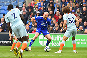 Aron Gunnarsson (17) of Cardiff City takes on David Luiz (30) of Chelsea during the Premier League match between Cardiff City and Chelsea at the Cardiff City Stadium, Cardiff, Wales on 31 March 2019.