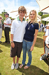 LORD SETTRINGTON and his sister LADY ALEXANDRA GORDON-LENNOX at a luncheon hosted by Cartier for their sponsorship of the Style et Luxe part of the Goodwood Festival of Speed at Goodwood House, West Sussex on 5th July 2009.