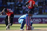 Jos Buttler (WK) almost run out by MS Dhoni (WK) during the International T20 match between England and India at Old Trafford, Manchester, England on 3 July 2018. Picture by George Franks.