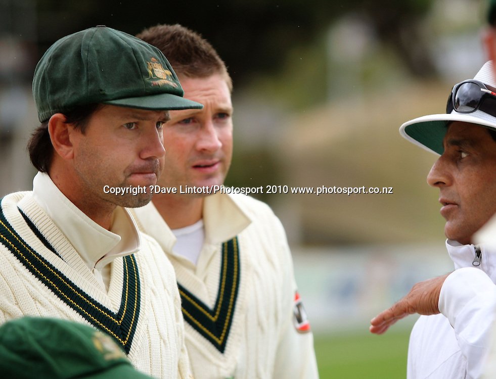 Umpire Asad Rauf (right) explains the situation to Australian captain Ricky Ponting (left) and vice-captain Michael Clarke.<br /> 1st cricket test match - New Zealand Black Caps v Australia, day four at the Basin Reserve, Wellington. Monday, 21 March 2010. Photo: Dave Lintott/PHOTOSPORT