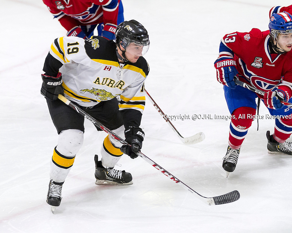 AURORA, ON - Mar 17, 2015 : Ontario Junior Hockey League game action between the Aurora Tigers and the Kingston Vees.  Game three of the best of seven semi-final series, Keaton Ratcliffe #19 of the Aurora Tigers battles for position during a second period face-off.<br /> (Photo by Stephen DiNallo / OJHL Images)