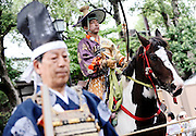 A horseback archer dressed in traditional hunting garb is escorted along a 255-meter course during the Yabusame Shinji, a Japanese ritual, at Tsurugaoka Hachimangu shrine in Kamakura, near Tokyo. The ritual, which involves several riders on horseback firing arrows at targets while galloping at speed, dates back to the 12th century and is aimed at appeasing the numerous gods that guard Japan. It was initiated by Kamakura shogun Minamoto no Yoritomo  in an attempt to improve his samurai warrior's appalling archery skills.