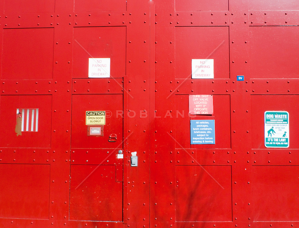 Signs On A Red Wall And Doors