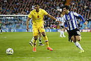 Sheffield Wednesday midfielder, on loan from Celta Vigo, Alex Lopez (21)  goes past MK Dons defender Jordan Spence (12)  during the Sky Bet Championship match between Sheffield Wednesday and Milton Keynes Dons at Hillsborough, Sheffield, England on 19 April 2016. Photo by Simon Davies.