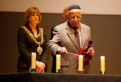 © Licensed to London News Pictures. 22/01/2012, Birmingham, UK. People gathered in the Towm Hall, Birmingham, to mark the anniversary of the liberation of the Auschwitz and Birkeneau concentration camps 67 years ago. Pictured, David Bloom, husband of the late Magda Bloom, Holocaust Survivor. Photo credit : Dave Warren/LNP