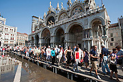 Venice, Italy, sept. 2009.  High water and tourists in San Marco's square. Venezia, Piazza San Marco