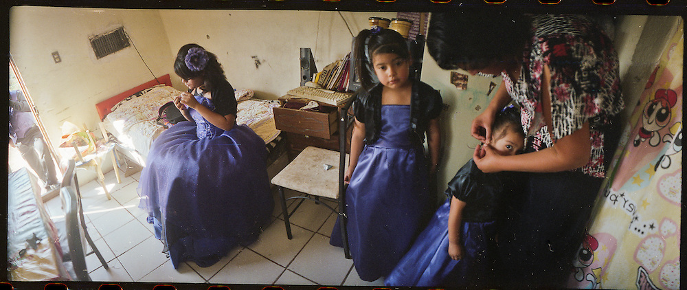 "A mother, center, prepares her daughters for a ""Quinceniera"" or 15th birthday party at their home in Ciudad Juarez, Mexico in 2010."
