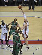 Cleveland's Zydrunas Ilgauskas shoots over the Boston defense.