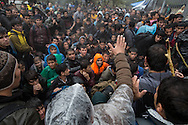 Fighting breaks out among asylum seekers while waiting in line to be registered to travel through Europe at Moria, a former corrections facility converted into a registration hotspot on the island of Lesvos, Greece, on October 19, 2015. Asylum seekers who arrived on Lesvos by sea from Turkey are required to be registered and approved to travel by Greek police before leaving the island. In October and November, over 300,000 thousand asylum seekers were registered at Moria and other hotspots on Lesvos. Most waited for up to a week, sleeping on the group with limited access to food, water and no bathrooms, in a line that stretched for over a kilometer to be registered at Moria.