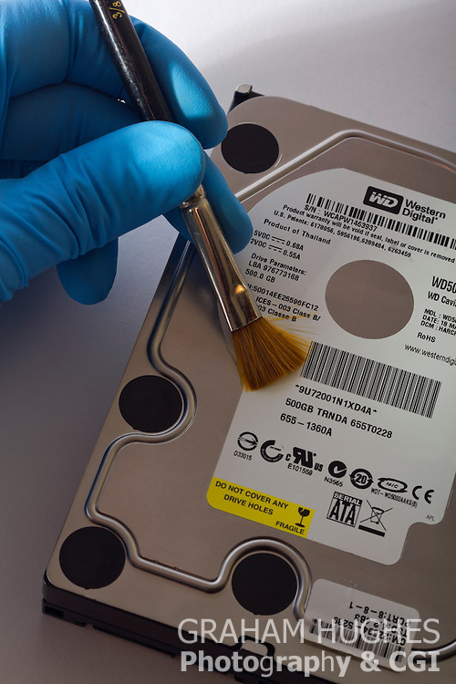 Computer Hard Drive With Hand Holding Brush