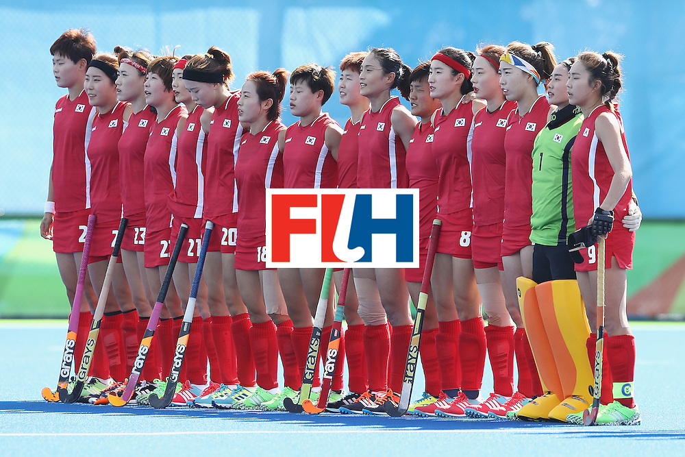 RIO DE JANEIRO, BRAZIL - AUGUST 07:  The Korea team sing the anthem before the women's pool A match between New Zealand and the Republic of Korea on Day 2 of the Rio 2016 Olympic Games at the Olympic Hockey Centre on August 7, 2016 in Rio de Janeiro, Brazil.  (Photo by Getty Images/Getty Images)