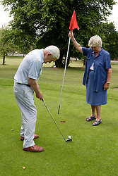 Older couple playing pitch and putt,