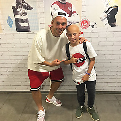 """Lukas Podolski releases a photo on Twitter with the following caption: """"""""One of my biggest fan in the world, a true fighter 💪🏻 Thank you always supporting 👊🏻❤#LP10 #Fight #Love"""""""". Photo Credit: Twitter *** No USA Distribution *** For Editorial Use Only *** Not to be Published in Books or Photo Books ***  Please note: Fees charged by the agency are for the agency's services only, and do not, nor are they intended to, convey to the user any ownership of Copyright or License in the material. The agency does not claim any ownership including but not limited to Copyright or License in the attached material. By publishing this material you expressly agree to indemnify and to hold the agency and its directors, shareholders and employees harmless from any loss, claims, damages, demands, expenses (including legal fees), or any causes of action or allegation against the agency arising out of or connected in any way with publication of the material."""