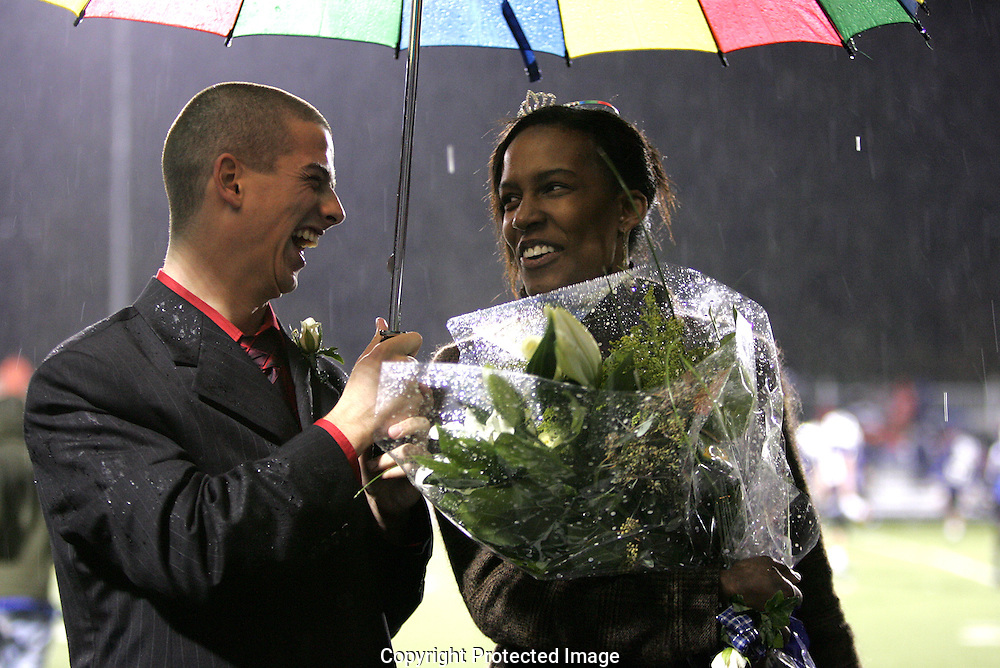 Adam Gray (left) escorted Quincy Alexander (right) who was crowned homecoming queen Friday October 24, 2008.