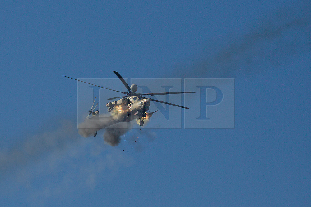 20/02/2017. Abu Saif, Iraq. An Iraqi Army Aviation Mi-28 Havoc fires rockets at Islamic State positions in Albu Saif during the West Mosul Offensive as it supports Iraqi troops fighting in the city.<br /> <br /> Iraqi forces reported today that one of its attack helicopters, supporting the ongoing Mosul Offensive, was shot down by Islamic State militants.