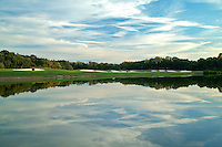 Beautiful skies surround Fairway an Green across water