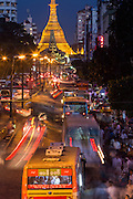 Rush hour traffic at night down Maha Bandula Road to Sule Pagoda, Yangon