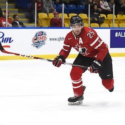 WHITBY, - Dec 13, 2015 -  WJAC Game 2- Team Switzerland vs Team Canada East at the 2015 World Junior A Challenge at the Iroquois Park Recreation Complex, ON. Maxime St. Pierre #25 of Team Canada East pursues the play during the first period.<br /> (Photo: Andy Corneau / OJHL Images)