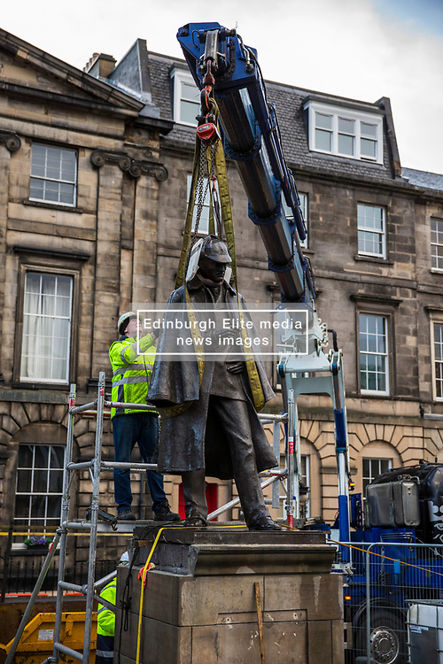 The sculpture of Sherlock Holmes by former pop-artist Gerald Laing is being moved from it's home on Picardy Place, yards from the birth place of Sir Arthur Conan Doyle.<br /> <br /> The move of the sculpture is to accommodate road and tram works that are taking place in Edinburgh. The statue will be moved to Nairn at  Black Isle Bronze Ltd by the artists son, Farquhar Laing where it will stay for two years until it returns to Edinburgh.<br /> <br /> Pictured: Artists son, Farquhar Laing checking the lifting straps