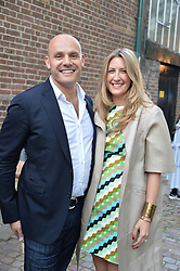 JONATHAN KRON and GEORGINA COHEN at a private view in aid of Chickenshed of Julian Schnabel's first UK solo show of paintings for 15 years entitled 'Every Angel Has A Dark Side' held at the Dairy Art Centre, 7a Wakefield Street, Bloomsbury, London on 24th April 2014.