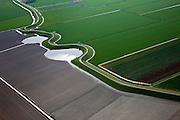 Nederland, Noord-Holland, Gemeente Harenkarspel, 28-04-2010; Westfriese Zeedijk, onderdeel van de Westfriese Omringdijk, de vroegere zeewering, omgeving Tuitjenhorn. De wielen zijn restanten van vroegere dijkdoorbraken..Westfriese Dijk, part of the 'Westfrisian Surrounding Dike'. The water is the remnant of dike breaches is  the past.luchtfoto (toeslag), aerial photo (additional fee required).foto/photo Siebe Swart