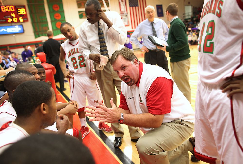 Anderson High School head basketball coach Joe Nadaline talks to his team during a timeout against Muncie Central in Anderson, Ind. The team recently started playing at the high school gym instead of the historical Wigwam gym...Photo by Chris Bergin