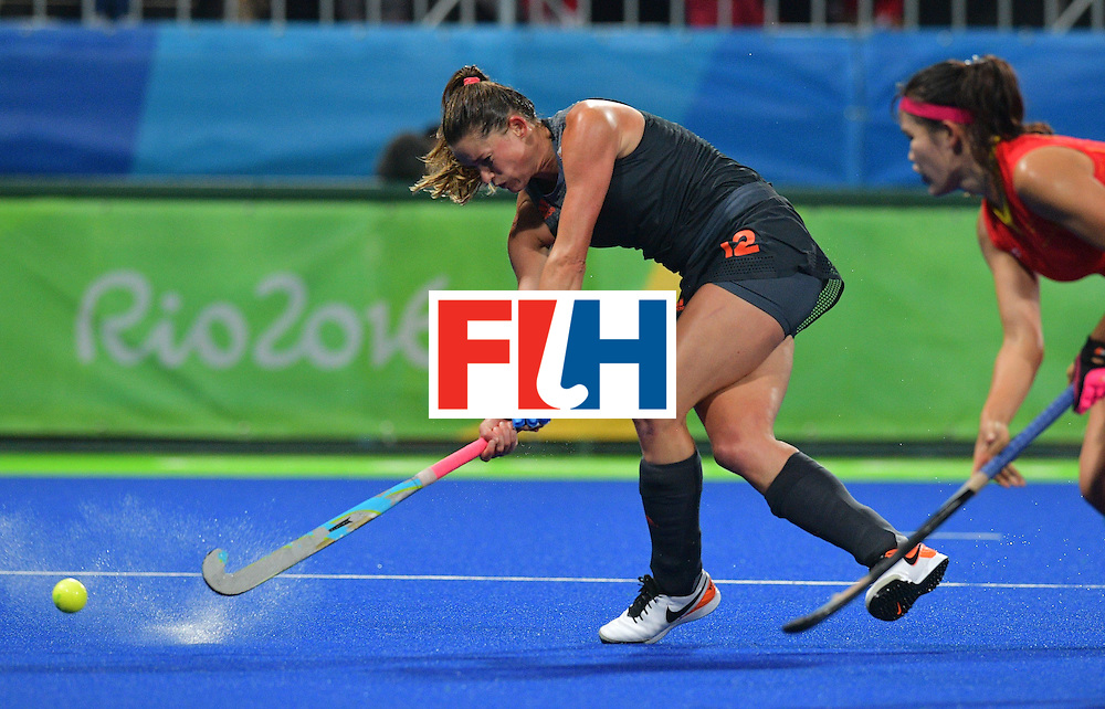 Netherland's Lidewij Welten hits the ball during the women's field hockey China vs Netherlands match of the Rio 2016 Olympics Games at the Olympic Hockey Centre in Rio de Janeiro on August, 10 2016. / AFP / Carl DE SOUZA        (Photo credit should read CARL DE SOUZA/AFP/Getty Images)