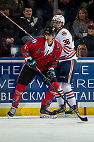 KELOWNA, CANADA - MARCH 9: Alex Swetlikoff #17 of the Kelowna Rockets checks Jackson Caller #38 of the Kamloops Blazers on March 9, 2019 at Prospera Place in Kelowna, British Columbia, Canada.  (Photo by Marissa Baecker/Shoot the Breeze)