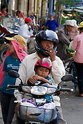 Phnom Penh, Cambodia. Family on a moped.