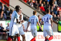 Tammy Abraham of England U21 celebrates with Jack Grealish after scoring a goal to make it 5-0 - Rogan Thomson/JMP - 11/10/2016 - FOOTBALL - Bescot Stadium - Walsall, England - England U21 v Bosnia and Herzegovina - UEFA European Under 21 Championship Qualifying.