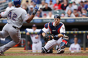 MINNEAPOLIS, MN - APRIL 15: Catcher Joe Mauer #7 of the Minnesota Twins tags out Adrian Beltre of the Texas Rangers on a play at home plate during their game at Target Field on April 15, 2012 in Minneapolis, Minnesota. (Photo by Joe Robbins)