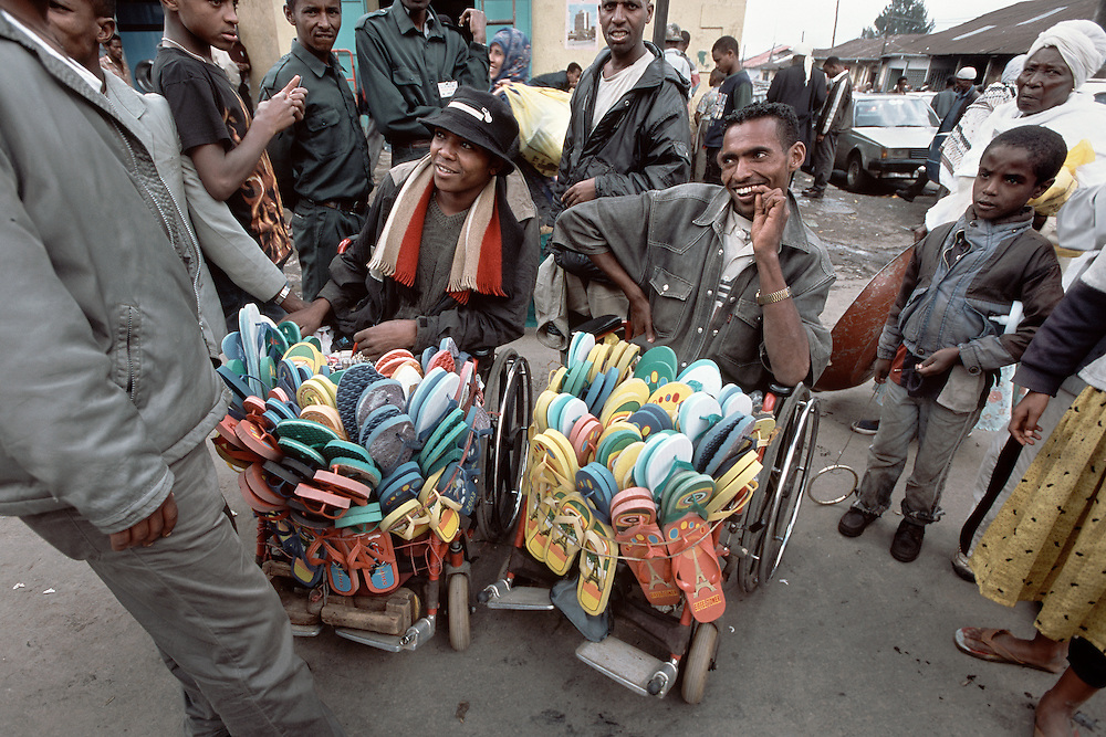 Men sell sandals from their wheelchairs in Addis Ababa, Ethiopia.